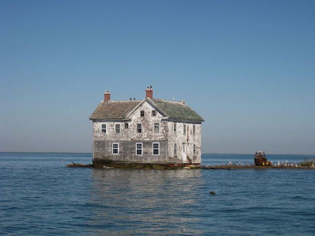 The last house on Holland Island in October 2009. It fell into the bay in October 2010. Source.